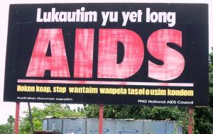 Papan informasi tentang HIV & AIDS dalam bahasa lokal. Sumber foto: Dokumen pribadi